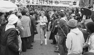 FILE- In this Oct. 24, 1976 file photo, Bill Rodgers crosses the finish line to win the 1976 New York City Marathon. Forty years ago, Rodgers, one the world's top two marathon runners was handed $3,000 as a secret reward for spicing up the very first five-borough New York City Marathon. (AP Photo/LW, File)