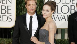 In this Jan. 15, 2007 file photo, Brad Pitt, and actress Angelina Jolie arrive for the 64th Annual Golden Globe Awards in Beverly Hills, Calif. The Hollywood power couple are in the midst of a contentious divorce. (AP Photo/Mark J. Terrill, File) **FILE**