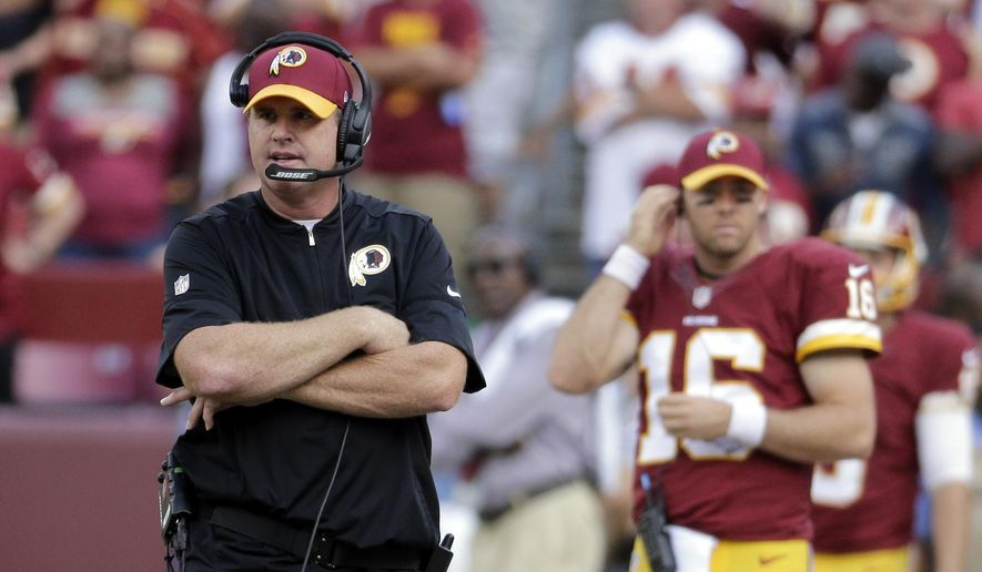 In this Oct. 2, 2016, file photo, Washington Redskins head coach Jay Gruden walks the sidelines during the second half of an NFL football game against the Cleveland Browns, in Landover, Md. A week after a last-minute loss at the Detroit Lions, they went into their bye week 4-3-1 and not quite sure how to feel.  (AP Photo/Chuck Burton, File)