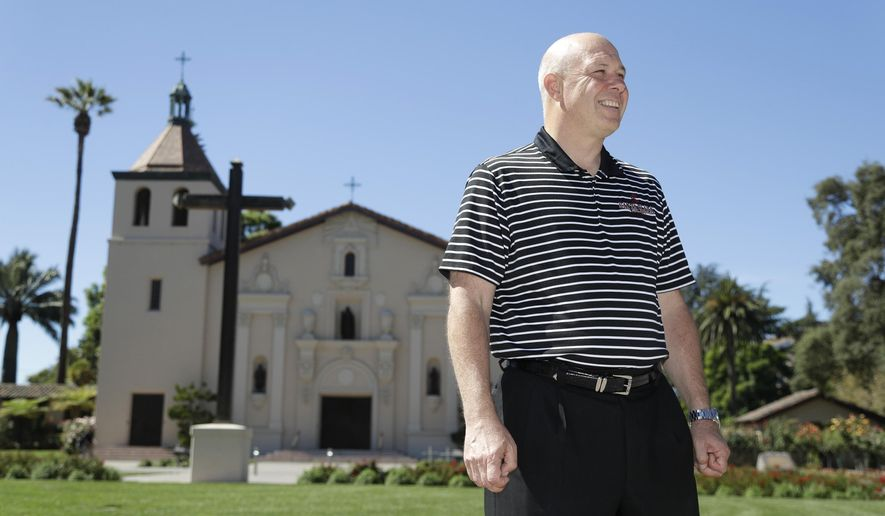 ADVANCE FOR WEEKEND EDITIONS, NOV. 5-6 - In this Sept. 23, 2016 photo, Santa Clara men's basketball coach Herb Sendek poses near the iconic Mission church on the university's campus in Santa Clara, Calif. While Sendek is running things at Santa Clara, Damon Stoudamire and Terry Porter have brought some serious NBA pedigree to coaching in the mid-major West Coast Conference. The league is suddenly full of some new, high-profile coaching names. (AP Photo/Marcio Jose Sanchez)