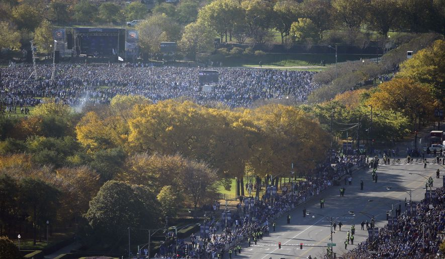 Fans gather at Grant Park for a parade honoring the World Series champion Chicago Cubs baseball team, Friday, Nov. 4, 2016, in Chicago. (AP Photo/Kiichiro Sato)