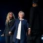 Democratic presidential candidate Hillary Clinton, center, is welcomed to the stage by artists Jay Z, right, and Beyonce, left, during a free concert at at the Wolstein Center in Cleveland, Friday, Nov. 4, 2016. (AP Photo/Andrew Harnik)