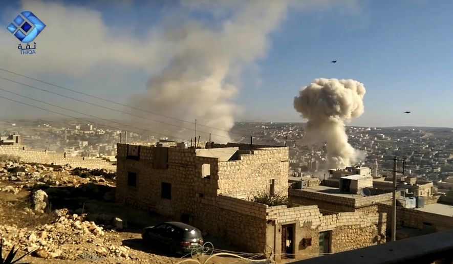 In this image taken from video provided by the activist-run Thiqa News Agency, consistent with independent AP reporting, a plume of smoke rises after a missile falls on the town of Darat Izza, Aleppo, Syria, Saturday, Nov. 5, 2016. Syrian activists are reporting Russian and government airstrikes have kept up on western rural Aleppo province against rebel positions despite a halt to airstrikes in the besieged eastern part of Aleppo city. (Thiqa News Agency, via AP)