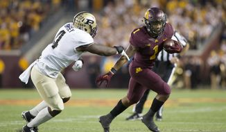 Minnesota running back Rodney Smith (1) plays during an NCAA college football game against Purdue, Saturday, Nov. 5, 2016 in Minneapolis. (AP Photo/Paul Battaglia)