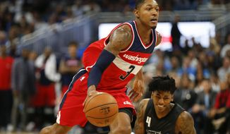 Washington Wizards guard Bradley Beal (3) drives past Orlando Magic guard Elfrid Payton (4) during the second half of an NBA basketball game in Orlando, Fla., on Saturday, Nov. 5, 2016. (AP Photo/Reinhold Matay)