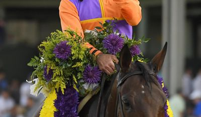 Gary Stevens celebrates after Beholder won the Breeders' Cup Distaff horse race at Santa Anita, Friday, Nov. 4, 2016, in Arcadia, Calif. (AP Photo/Mark J. Terrill)