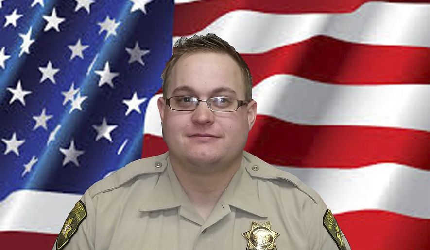 FILE - This undated photo provided by the Modoc County, Calif., Sheriff's Department shows Deputy Jack Hopkins. Hopkins, 31, was shot to death Wednesday, Oct. 19, 2016, while responding to a disturbance call, the Modoc County Sheriff's Office said. (Modoc County Sheriff's Department via AP, File)