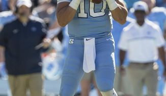 North Carolina quarterback Mitch Trubisky (10) drops back to pass during an NCAA college football game against Georgia Tech in Chapel Hill, N.C., Saturday, Nov. 5, 2016. (AP Photo/Ben McKeown)