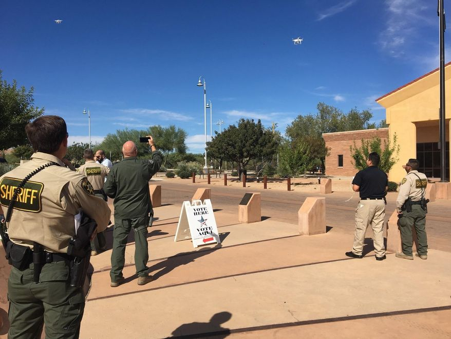 Pima County sheriff's deputies and officers from other law enforcement agencies view a demonstration of a drone Tuesday, Nov. 1, 2016 in Sahuarita, Ariz. The Sahuarita Police Department will be the first in the region to utilize aerial drones as an investigative tool. (Courtesy of James Lawrence via The AP)