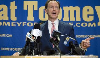 FILE - In this Oct. 11, 2016, file photo, Sen. Pat Toomey, R-Pa., campaigns in Villanova, Pa. Sen. Toomey is turning to the target of some of his toughest criticism to help him in his life-or-death re-election bid in Democratic-leaning Pennsylvania: President Barack Obama. (AP Photo/Matt Rourke, File)