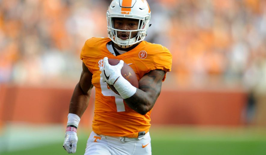 Tennessee running back John Kelly (4) runs for a touchdown against Tennessee Tech during the first half of an NCAA college football game Saturday, Nov. 5, 2016, in Knoxville, Tenn. (Caitie McMekin/Knoxville News Sentinel via AP)