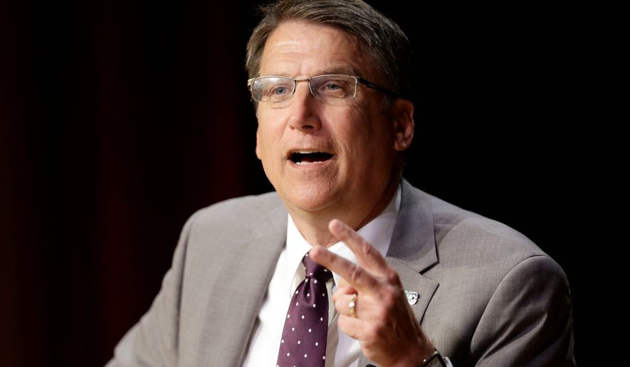 North Carolina Gov. Pat McCrory has taken a beating from critics over a law dictating which restrooms transgender people can use, pointing it its economic harm and the declining reputation of the state. (Associated Press)