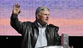 Evangelist Franklin Graham continues to call on Americans to pray for President Trump, and now calls hostile media coverage of the White House  'sickening'. (Associated Press)