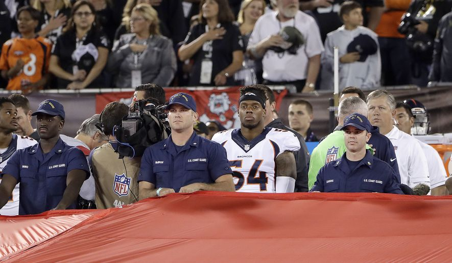 Denver Broncos linebacker Brandon Marshall (54) stands during the national anthem before an NFL football game against the Oakland Raiders in Oakland, Calif., Sunday, Nov. 6, 2016. (AP Photo/Marcio Jose Sanchez)