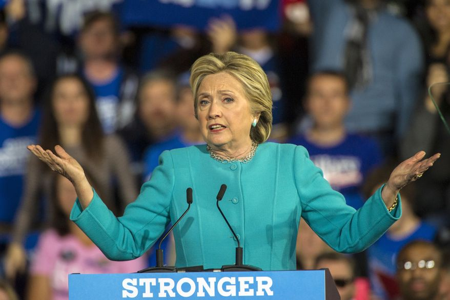 Democratic presidential candidate Hillary Clinton speaks during a campaign rally at Cleveland Public Hall in Cleveland, Sunday, Nov. 6, 2016. (AP Photo/Phil Long)