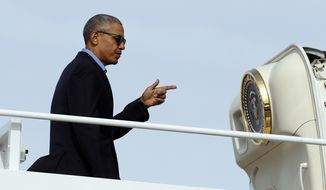 President Barack Obama points as he boards Air Force One in Andrews Air Force Base, Md., Sunday, Nov. 6, 2016, en route to Florida, where he will speak at a campaign event for Democratic presidential candidate Hillary Clinton at Osceola County Stadium. (AP Photo/Carolyn Kaster)