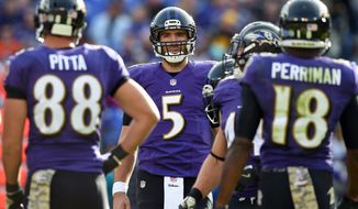 Baltimore Ravens quarterback Joe Flacco (5) huddles with teammates in the first half of an NFL football game against the Pittsburgh Steelers, Sunday, Nov. 6, 2016, in Baltimore. (AP Photo/Gail Burton)
