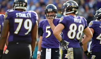 Baltimore Ravens quarterback Joe Flacco (5) wipes his face as he huddles with teammates in the first half of an NFL football game against the Pittsburgh Steelers, Sunday, Nov. 6, 2016, in Baltimore. (AP Photo/Gail Burton)