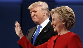 Donald Trump stands with Hillary Clinton at the first presidential debate on Sept. 26, 2016, at Hofstra University in Hempstead, New York. (Associated Press) **FILE**
