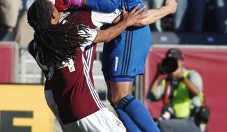 Colorado Rapids goalkeeper Tim Howard, right, celebrates with defender Marc Burch, back left, and midfielder Marlon Hairston after Howard stopped a kick by Los Angeles Galaxy defender Jeff Larentowicz in the second leg soccer match of the Western Conference semifinals of the MLS cup playoffs in Commerce City, Colo., on Sunday, Nov. 6, 2016. Colorado won 1-0 and advances to the next round of the playoffs. (AP Photo/David Zalubowski)