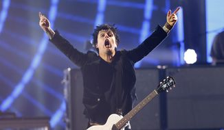 Billie Joe Armstrong of Green Day gestures as they perform, during the MTV European Music Awards 2016, in Rotterdam, Netherlands, Sunday, Nov. 6, 2016. (AP Photo/Peter Dejong)