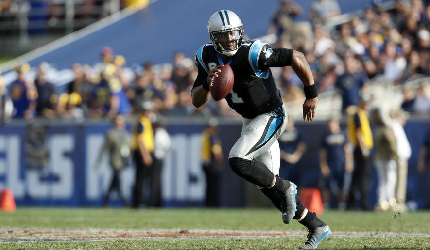 Carolina Panthers quarterback Cam Newton runs the ball during the first half of an NFL football game against the Los Angeles Rams, Sunday, Nov. 6, 2016, in Los Angeles. (AP Photo/Ryan Kang)