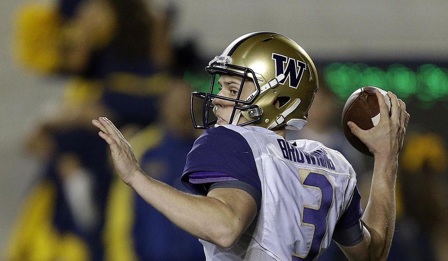 Washington quarterback Jake Browning passes against California during the first quarter of an NCAA college football game Saturday, Nov. 5, 2016, in Berkeley, Calif. (AP Photo/Ben Margot)