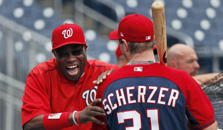 Washington Nationals manager Dusty Baker and starting pitcher Max Scherzer share a laugh during baseball batting practice at Nationals Park, Thursday, Oct. 6, 2016, in Washington. The Nationals host the Los Angeles Dodgers in Game 1 of the National League Division Series on Friday. (AP Photo/Alex Brandon) **FILE**