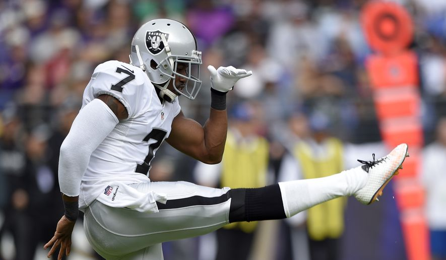 Oakland Raiders punter Marquette King follows through on a punt in the first half of an NFL football game against the Baltimore Ravens, Sunday, Oct. 2, 2016, in Baltimore. (AP Photo/Nick Wass)
