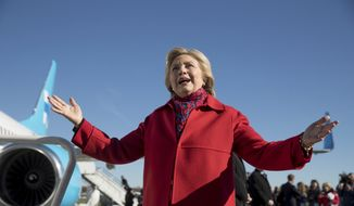Democratic presidential candidate Hillary Clinton speaks to members of the media before boarding her campaign plane at Westchester County Airport in White Plains, N.Y., Monday, Nov. 7, 2016, to travel to Pittsburgh. (AP Photo/Andrew Harnik)