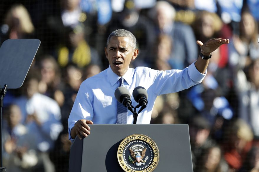 President Barack Obama campaigns for Democratic presidential candidate Hillary Clinton, Monday, Nov. 7, 2016, at the University of Michigan in Ann Arbor, Mich. (AP Photo/Carlos Osorio)