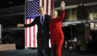 President Obama joins Hillary Clinton on stage during a rally Monday at Independence Hall in Philadelphia. (Associated Press)