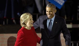 President Barack Obama and Democratic presidential candidate Hillary Clinton walk off stage after both spoke at a rally at Independence Mall in Philadelphia. Monday, Nov. 7, 2016. (AP Photo/Pablo Martinez Monsivais) ** FILE **