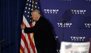 Republican presidential candidate Donald Trump hugs an American flag after speaking at a rally Monday, Nov. 7, 2016 in Leesburg, Va. (AP Photo/Alex Brandon)
