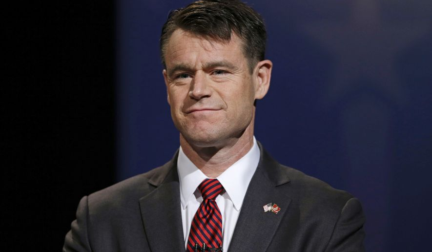 Indiana U.S. Senate Republican candidate Todd Young participates in a debate in Indianapolis on Oct. 18, 2016. (Associated Press) **FILE**