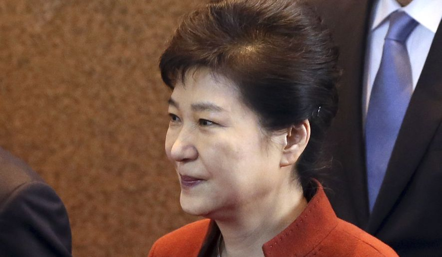 South Korean President Park Geun-hye arrives to meets with National Assembly Speaker Chung Sye-kyun at the National Assembly in Seoul, South Korea, Tuesday, Nov. 8, 2016. South Korea's president said Tuesday she will allow parliament to choose her prime minister, a major political concession to growing anger as she scrambles to defuse an escalating influence-peddling scandal. (Bae Jae-man/Yonhap via AP) KOREA OUT