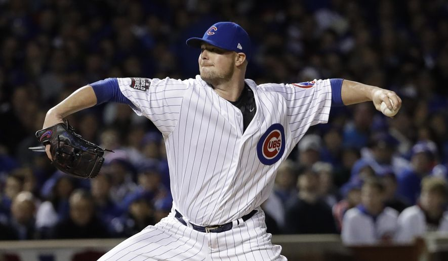 FILE - This Oct. 30, 2016 file photo shows Chicago Cubs starting pitcher Jon Lester throwing during the first inning of Game 5 of the Major League Baseball World Series against the Cleveland Indians in Chicago. Fresh off leading the Cubs to their first World Series title in more than a century, slugger Kris Bryant and several teammates could soon be hoisting more hardware. Lester is up for the NL Cy Young Award. The Baseball Writers' Association of America announced the finalists Monday, Nov. 7, 2016. Voting was completed before the postseason, and the awards will be presented next week on MLB Network. (AP Photo/David J. Phillip, file)
