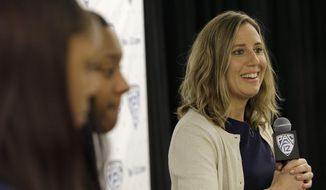 FILE - In this Thursday, Oct. 20, 2016, file photo, California head coach Lindsay Gottlieb, right, speaks during the Pac-12 NCAA college basketball media day in San Francisco. Gottlieb pulled off quite the surprise with her players Saturday, Nov. 5 : She's pregnant with her first child. She made the reveal during a team meeting on Saturday. (AP Photo/Jeff Chiu, File)