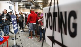 A line of early voters wait in queue at the Franklin County Board of Elections, Monday, Nov. 7, 2016, in Columbus, Ohio. Heavy turnout has caused long lines as voters take advantage of their last opportunity to vote before election day. (Associated Press) **FILE**