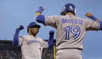 FILE -  This May 9, 2016 file photo shows Toronto Blue Jays' Edwin Encarnacion, left, celebrating with Jose Bautista (19) after hitting a two run home run off San Francisco Giants' Jake Peavy in the third inning of a baseball game in San Francisco. Bautista and Encarnacion were among 10 players to receive $17.2 million qualifying offers from their teams Monday, Nov. 7, 2016 as general managers gathered for their annual meeting. (AP Photo/Ben Margot, file)