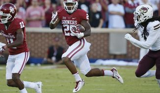 FILE - In this Sept. 10, 2016, file photo, Oklahoma running back Joe Mixon (25) carries during an NCAA college football game against Louisiana Monroe, in Norman, Okla. Mixon will be back Saturday for the Sooners, too. The Big 12's No. 2 rusher was suspended for last Thursday's win over Iowa State after having an issue with a parking attendant.(AP Photo/Sue Ogrocki, File)
