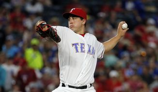 FILE - This Sept. 21, 2016 file photo shows Texas Rangers starting pitcher Derek Holland (45) throwing to the Los Angeles Angels in the second inning of a baseball game in Arlington, Texas. Holland has become a free agent after the Texas Rangers declined their $11 million option on his contract and instead chose to pay the left-hander a $1.5 million buyout. The AL West champions announced the move Monday, Nov. 7, 2016 but left open the possibility of re-signing Holland. (AP Photo/Tony Gutierrez, file)