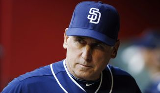 FILE - In this May 8, 2015, file photo, San Diego Padres' Bud Black paces in the dugout prior to a baseball game against the Arizona Diamondbacks in Phoenix. A person with knowledge of the situation tells The Associated Press that Bud Black has been hired as manager of the Colorado Rockies. The person spoke on condition of anonymity Sunday, Nov. 6, 2016 because the move had not yet been announced. (AP Photo/Ross D. Franklin, File)