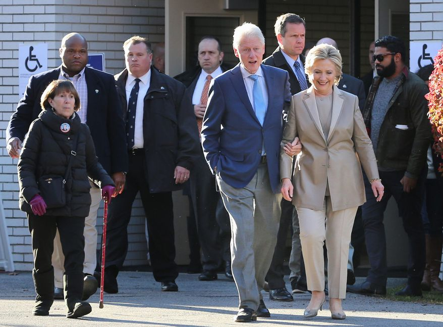 Democratic candidate Hillary Clinton, and her husband, former President Bill Clinton, leave their polling place in Chappaqua, New York.
