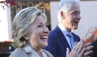 Democratic presidential candidate Hillary Clinton and her husband former President Bill Clinton greet supporters after voting in Chappaqua, N.Y., Tuesday, Nov. 8, 2016. (AP Photo/Seth Wenig)