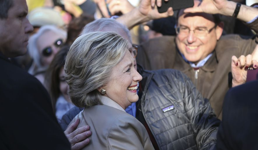 Supporters take pictures with democratic presidential candidate Hillary Clinton after she voted in Chappaqua, N.Y., Tuesday, Nov. 8, 2016. (AP Photo/Seth Wenig)