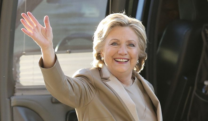 Democratic presidential candidate Hillary Clinton waves as she arrives to vote at her polling place in Chappaqua, N.Y., Tuesday, Nov. 8, 2016. (AP Photo/Seth Wenig)