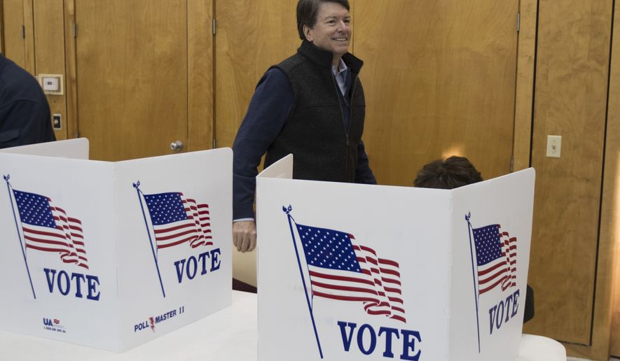 New York's 19th Congressional District Republican candidate John Faso votes at St. Paul's Episcopal Church on Tuesday, Nov. 8, 2016, in Kinderhook, N.Y. Faso is running against Democrat Zephyr Teachout. (AP Photo/Mike Groll)