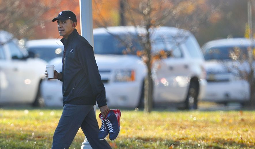 President Barack Obama carries a pair of sneakers as he arrives for a private game of basketball at Fort McNair in Washington, Tuesday, Nov. 8, 2016. Playing basketball on election day is a tradition for Obama. (AP Photo/Pablo Martinez Monsivais)