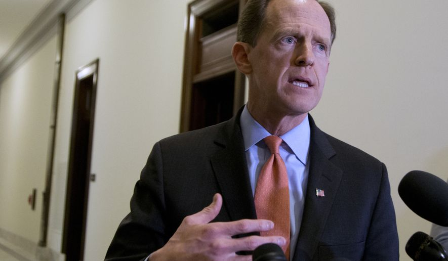 FILE - In this April 12, 2016 file photo, Sen. Patrick J. Toomey, R-Pa. speaks to reporters outside his office on Capitol Hill, in Washington.  (AP Photo/Manuel Balce Ceneta, File)